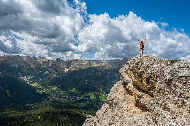 woman on the rock feeling free